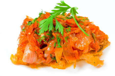 Roasted fish in tomato marinade with carrots isolated over white photo