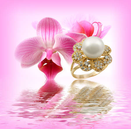 Elegant female jewelry ring with  with flowers orchids Stock Photo - 8637052