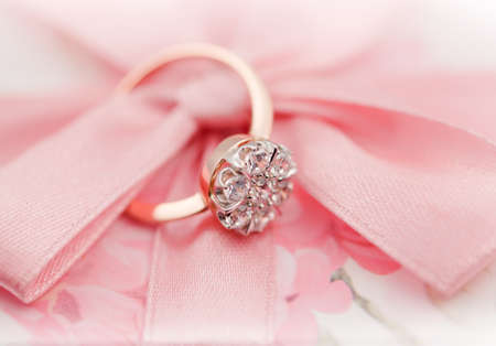 Elegant jewelry ring with jewel stone on a background of silky bow  photo