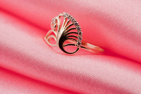 Elegant jewelry ring with jewel stone on a background of pink silk Stock Photo - 8637028