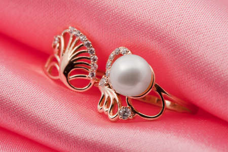Elegant jewelry ring with jewel stone on a background of pink silk Stock Photo - 8637022