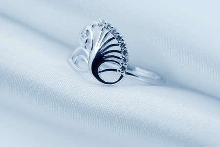 Elegant jewelry ring with jewel stone on a background of silk Stock Photo - 8637015