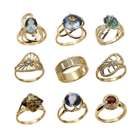 bijoux diamant: Les bijoux femme �l�gante golden anneaux isol�s sur blanc