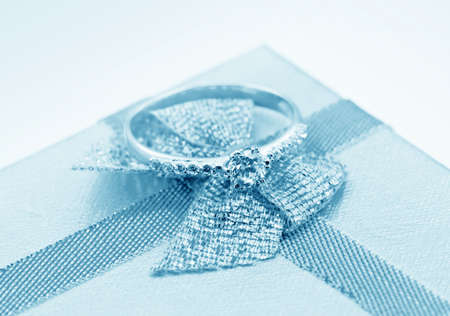 Elegant jewelry ring with jewel stone on a background of silky bow  Stock Photo - 8987735