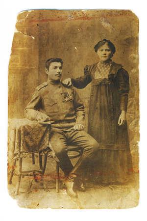 Retro a photo (1914 years)  from a family album, sepia. My grandad and grandmamma photo