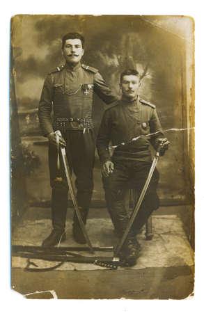 grandad: Retro a photo  (1914 years) from a family album, sepia. My grandads