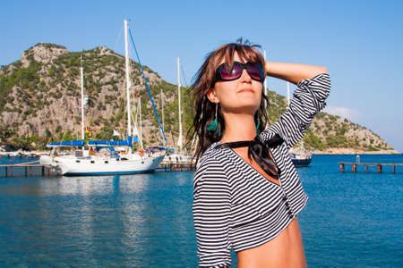 Happy young woman on holidays on the sea photo