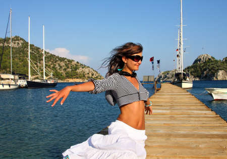 Happy young free woman on holidays on the sea photo