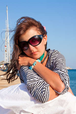 Happy young woman on holidays on the sea Stock Photo - 9398038