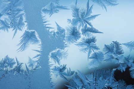 Frosty original  pattern at a winter window glass, natural texture  photo
