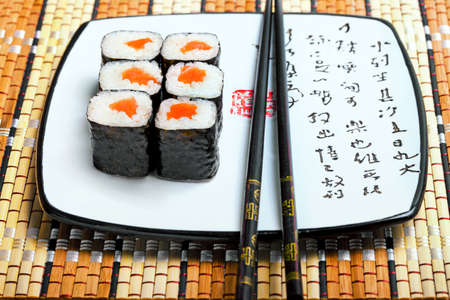 japanese cookery: East cooking - rolls and chopsticks on bamboo serviette