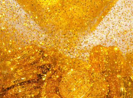 goldy: Monete Golen e sabbia Goldy, la consistenza naturale Archivio Fotografico