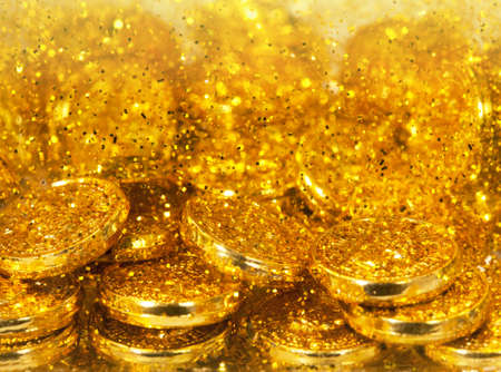 goldy: Golen coins and goldy sand, natural texture Stock Photo