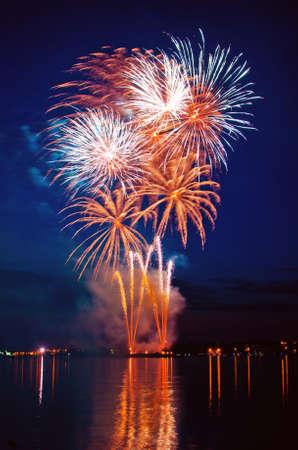 salvoes:  Ñelebratory bright firework in a night sky