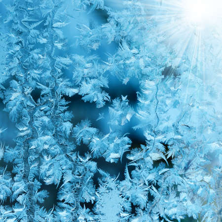 Frosty original  pattern at a winter window glass, natural texture Stock Photo - 11386554