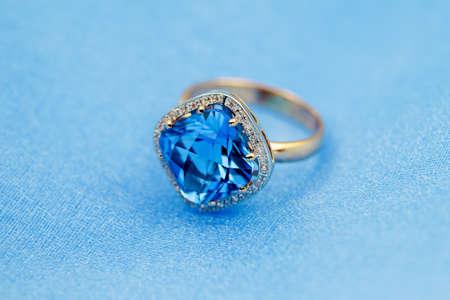 fine gold: Elegant jewelry ring with jewel stone  blue topaz  Stock Photo
