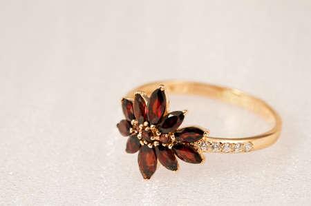 Elegant jewelry ring with jewel stone garnet photo