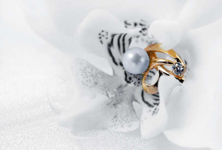 Elegant jewelry ring with white flower orchid Stock Photo