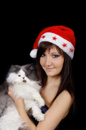 Charming young woman wit pet - persian cat photo