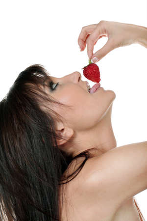 Charming young woman with red strawberry Stock Photo - 11980732