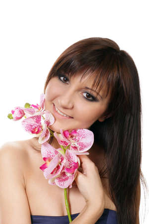 Charming young woman. Studio portrait with flower orchids photo