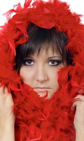 feather boa: Charming young woman. Fashion studio portrait in red boa