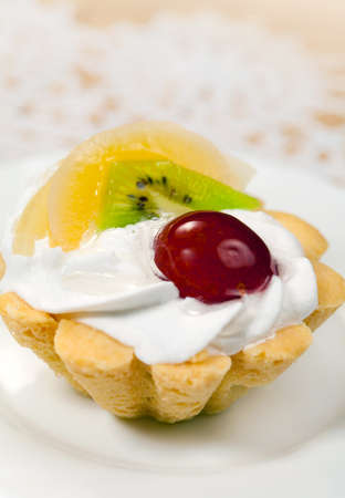Tasty tart basket with proteinic cream and fruits photo
