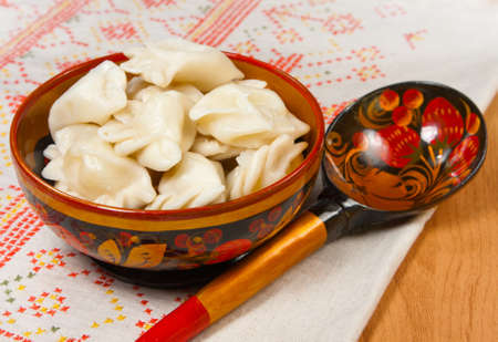 russian tradition: Food - plate with russian ravioli with meat on a table Stock Photo