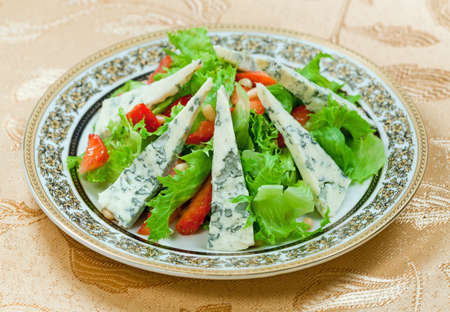 mustiness: Dietary salad with gorgonzolla and strawberry in plate
