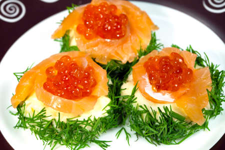 Snack with red salmon caviar with   fennel photo
