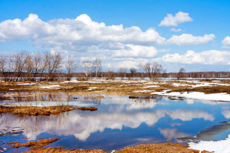 Spring    River  and   clouds reflected in water photo