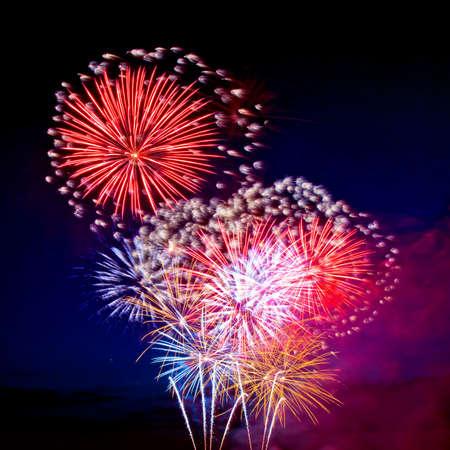 Celebratory bright firework in a night sky  Stock Photo