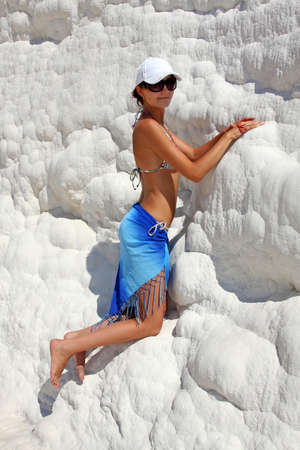 turkish woman: Travertine pools and terraces, Young woman in Pamukkale, Turkey