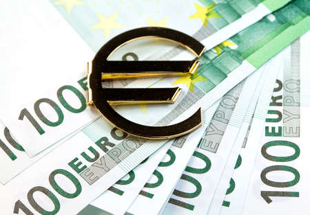 european exchange: The money euro. Bundle of bank notes  and golden sign