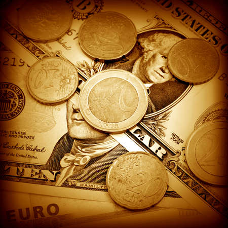 The money euro and dollars. Bundle of bank notes  and coins