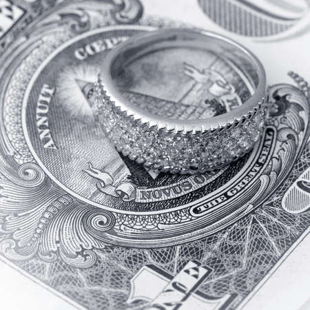 jewell: American dollars and jewelry   Bundle of bank notes and brilliant ring Stock Photo