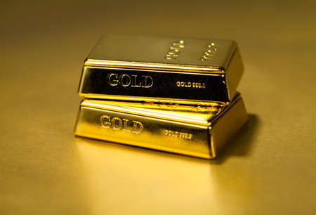 Gold bullion , high order , on a golden background photo