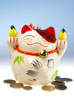 Preservation of capital, coins and japanese money-box - cat Stock Photo - 13208224