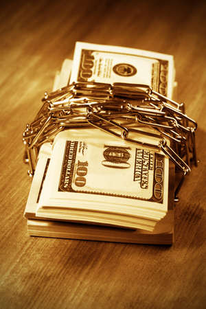 The money and  lock  Bundle of bank notes, preservation of capital photo