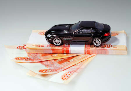 ruble: Russian roll of five thousand rubles and automobile