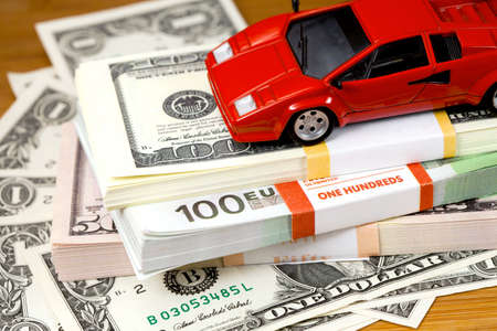 motorcar: The money euro and dollars  Bundle of bank notes  and small  motor-car Stock Photo