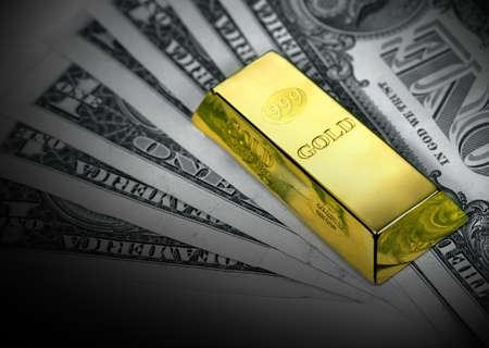 The money american dollars and gold bullion photo