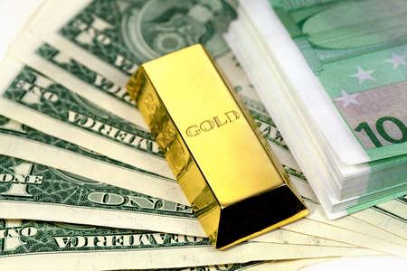 The money american dollars and gold bullion Stock Photo - 13471779