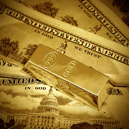 monies: The money american dollars and gold bullion Stock Photo