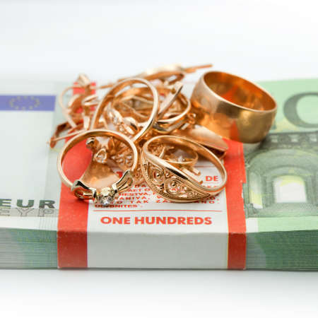 Jewelry and banknotes money on white background photo