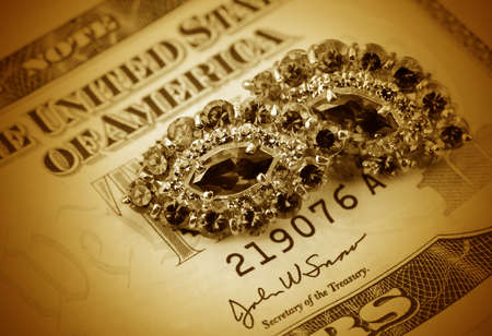 Jewelry on a background of  dollars close- up photo