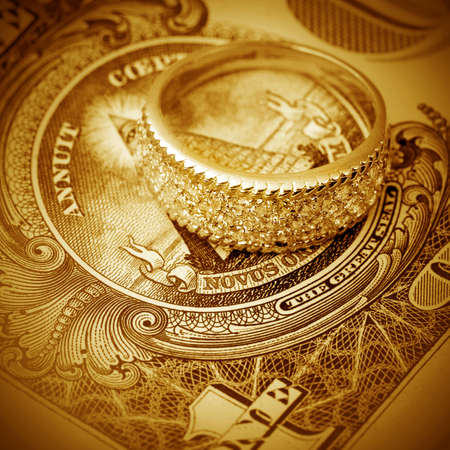 jewell: Jewelry on a background of  dollars close- up Stock Photo