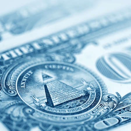 American dollars close- up in blue color photo