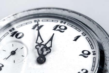 clock hands: Mechanical old watch close-up, twelve oclock Stock Photo