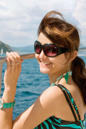 Happy young woman on holidays on the sea Stock Photo - 14409906